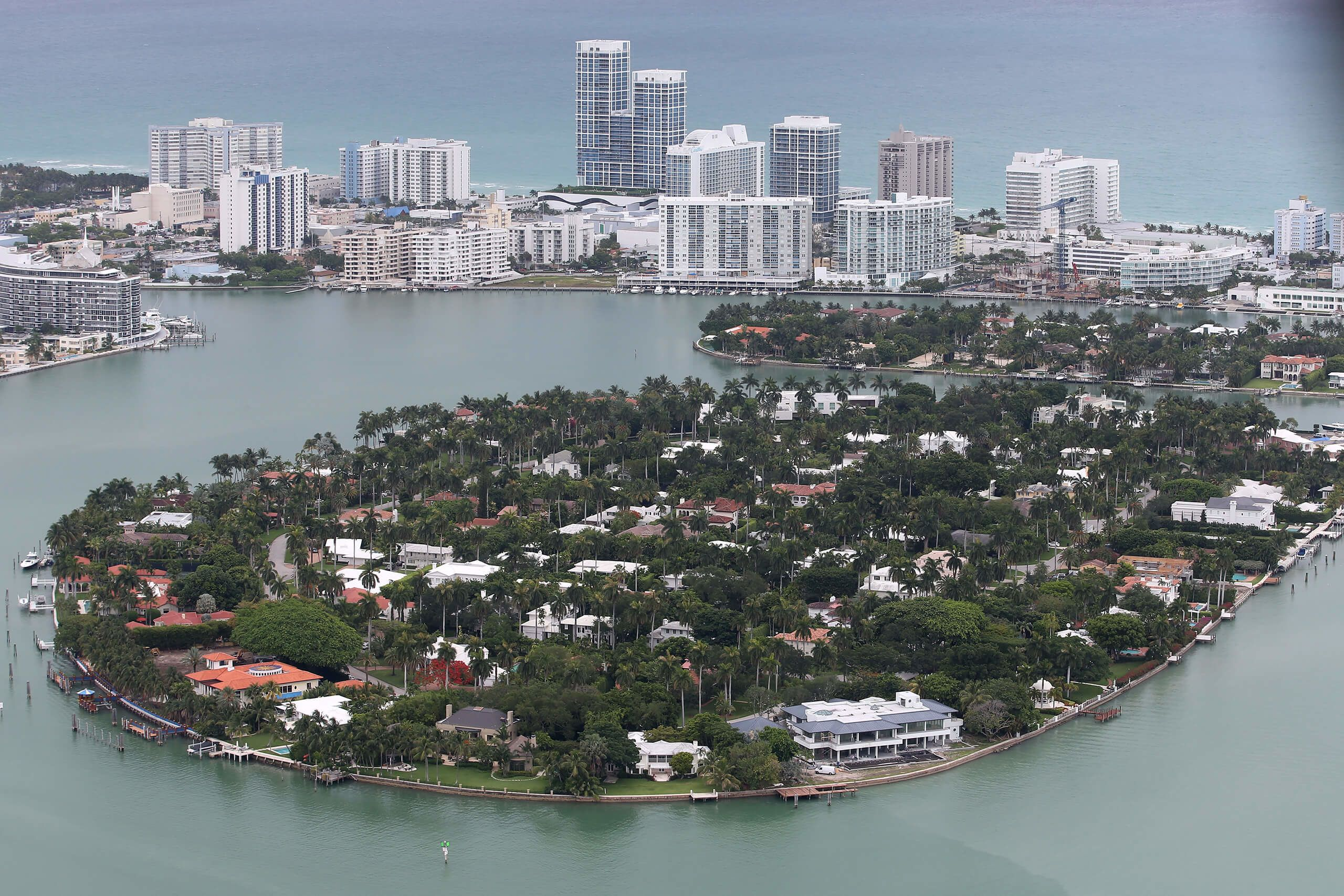 Miami and Miami Beach are flat, low-lying places surrounded by rising seas, and the ground underneath them is mostly porous limestone, which means water will eventually rise through it as well.