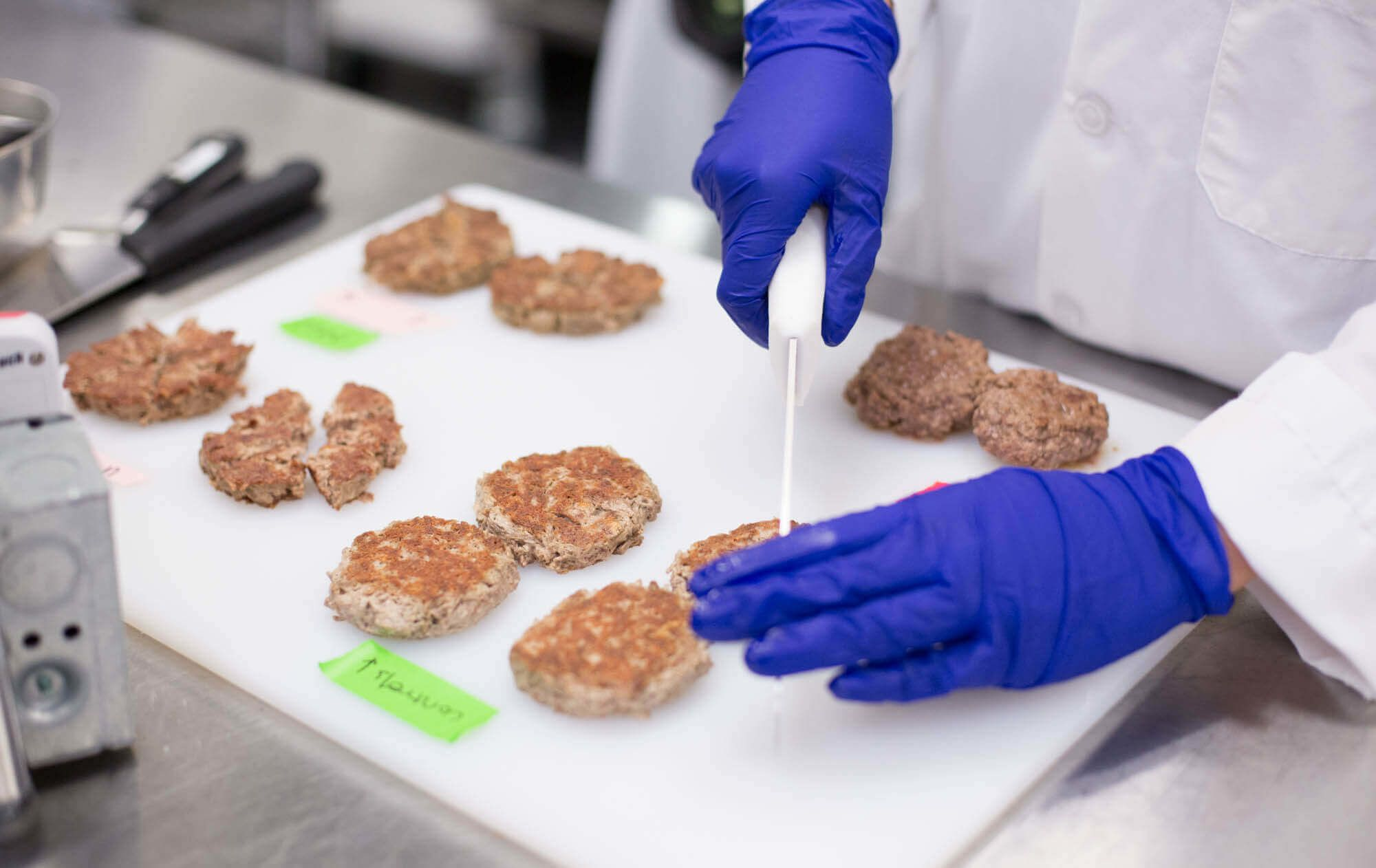 Scientists at Impossible Foods, a meatless burger startup backed by Bill Gates, experiment with different ingredients in their patty.