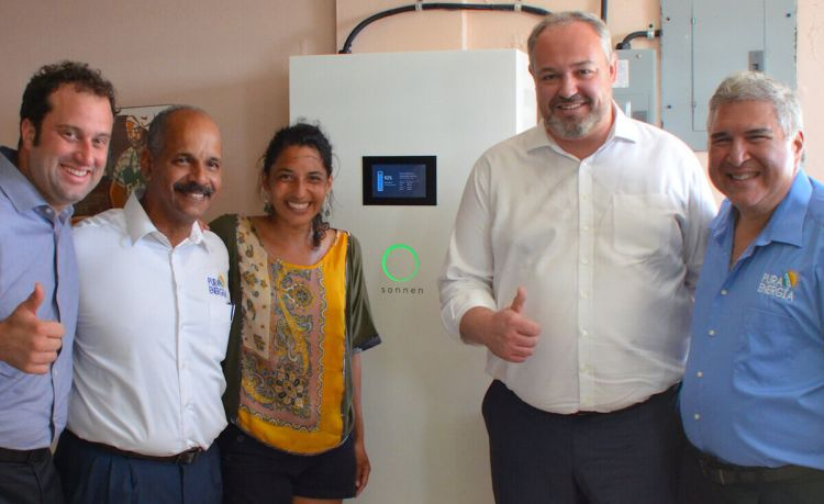 The Sonnen and Pura Energia teams in Humacao with their solar battery.